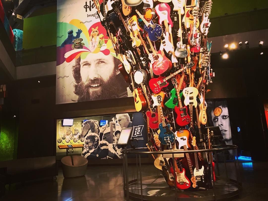 Photo by user ilka_paola, caption reads Amazing Guitar Exhibit at the Museum of Pop Culture in Seattle ! 🎸#guitars#guitarexibit#musuemofpopculture#northseattle#ilovemuseums#seattle#dtseattle#downtownseattle#washingtonstate#seattlewashington#exploringseattle#exploreseattle#tourismseattle#beingatourist#goldenhour#sunset#pacificnorthwest#pnw#walkingthestreets#downtowncruising#seattlelife#sunnydayinseattle#fallinseattle#solotraveler#solotravel#musuemgeek#citypass#seattlecitypass